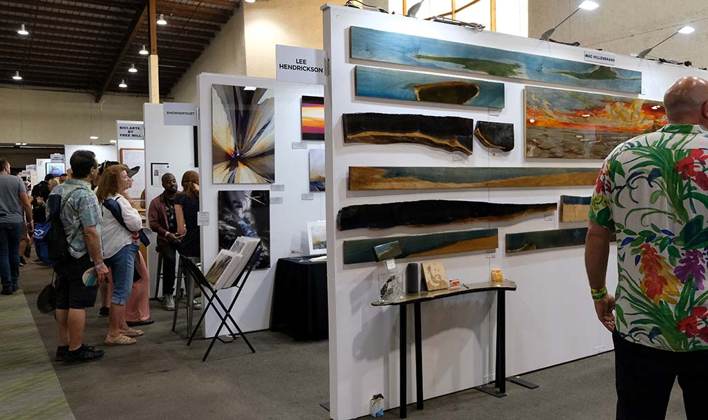 Attendees viewed completed art work and artists creating new works at the art exhibit at KAABOO Del Mar.