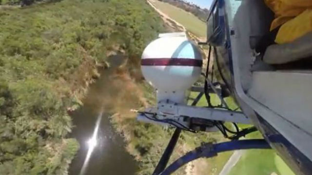 Helicopter drops larvicide