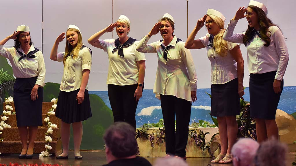 Survivor association and church members performed 1940s medleys including Boogie Woogie Bugle Boy.