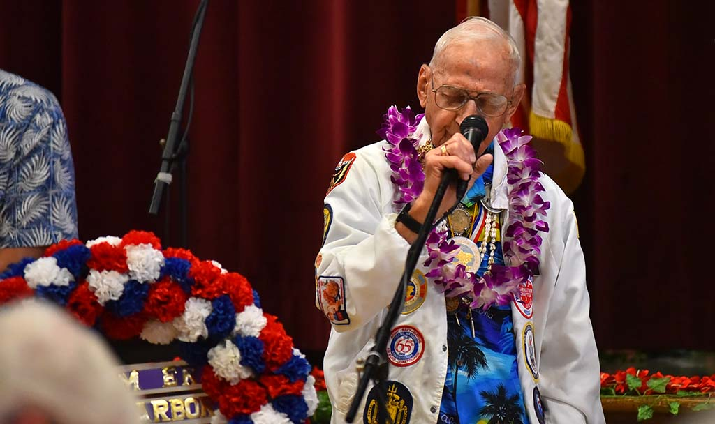 Pearl Harbor Survivor Association president Stu Hedley leads the group in prayer.