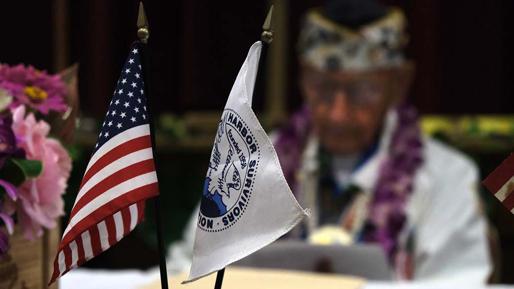 Pearl Harbor survivor flags were displayed along with the American flag at the meeting.