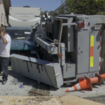 A work truck on its side after a crash.