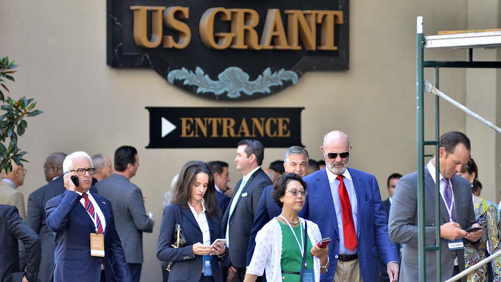 Attendees at a fundraiser for President Donald Trump leave the U.S. Grant Hotel in downtown San Diego.