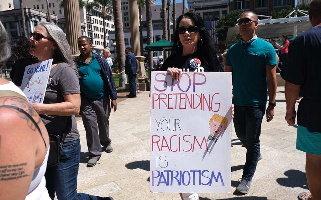While Trump supporters and detractors were positioned at separate intersections, people mixed in Horton Plaza Park.