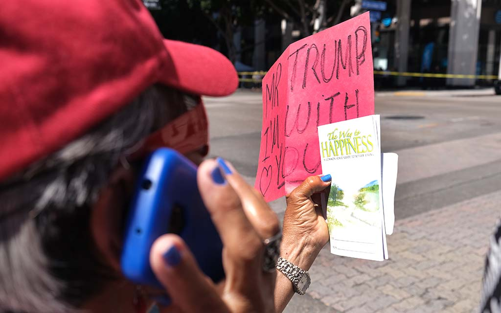 A President Trump supporter holds a handmade sign, showing her happiness with the president.