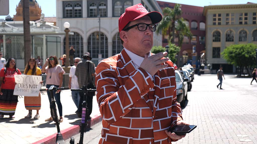 Blake Marnell of San Diego shows his support of the president by wearing his wall suit.