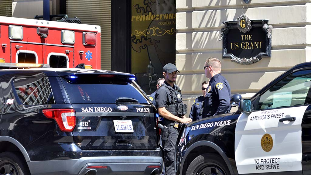 San Diego police and Secret Service agents guard the perimeter of the U.S. Grant Hotel where Trump was speaking.