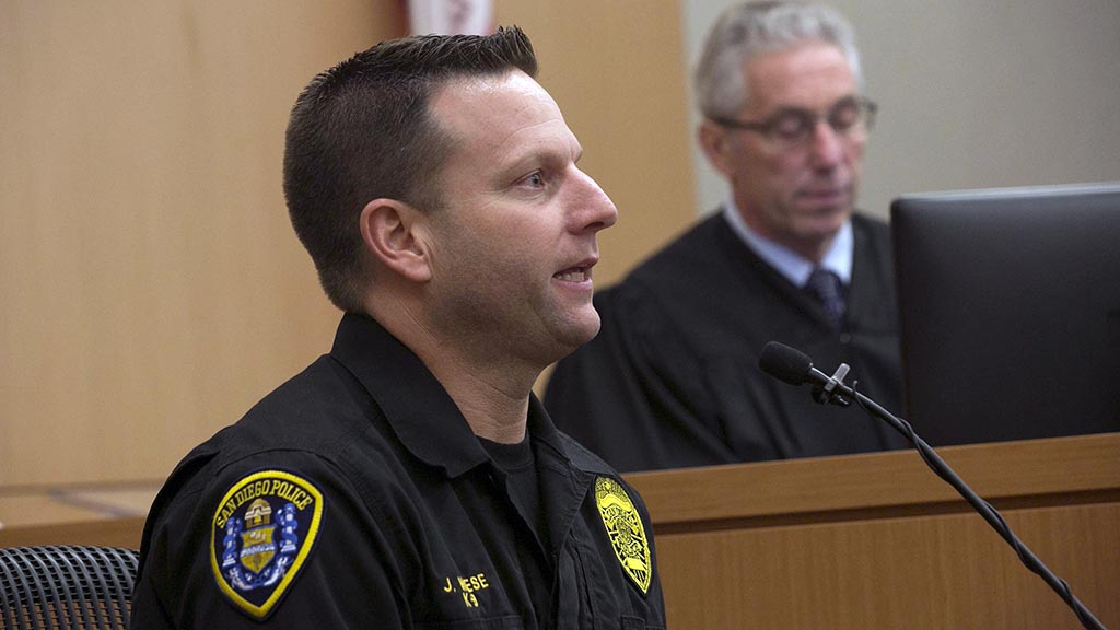 SDPD K-9 Officer Jonathan Wiese told about taking the defendant into custody shortly after the shooting.