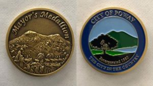 Poway Mayor Steve Vaus handed President Trump a mayor's medallion like this one.