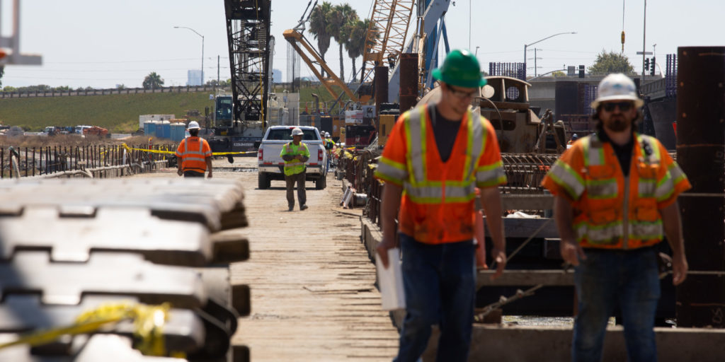 Construction crews work on the West Mission Bay Drive bridge, Aug. 26, 2019. Money allocated through the Rebuild San Diego ballot measure is helping fund the project.