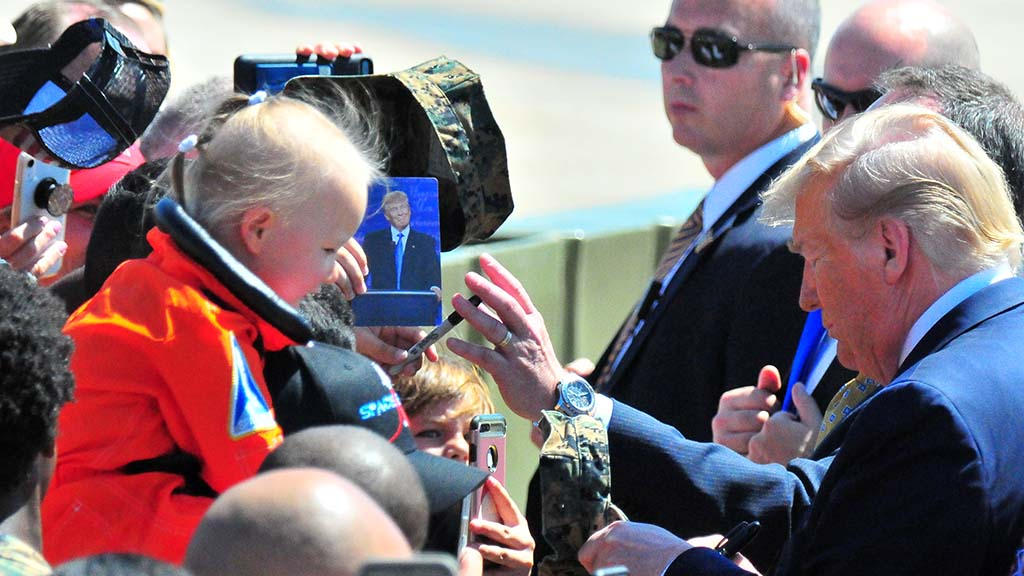 A little girl rides shoulders only feet away from the commander-in-chief.