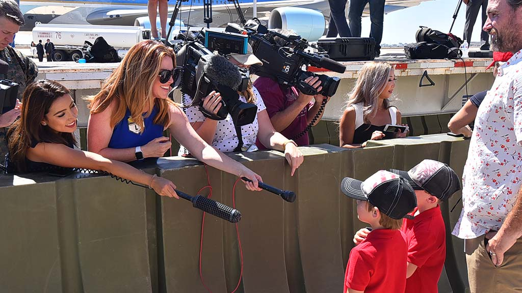 Local reporters interview children after President Trump departed Marine Corps Air Station Miramar.