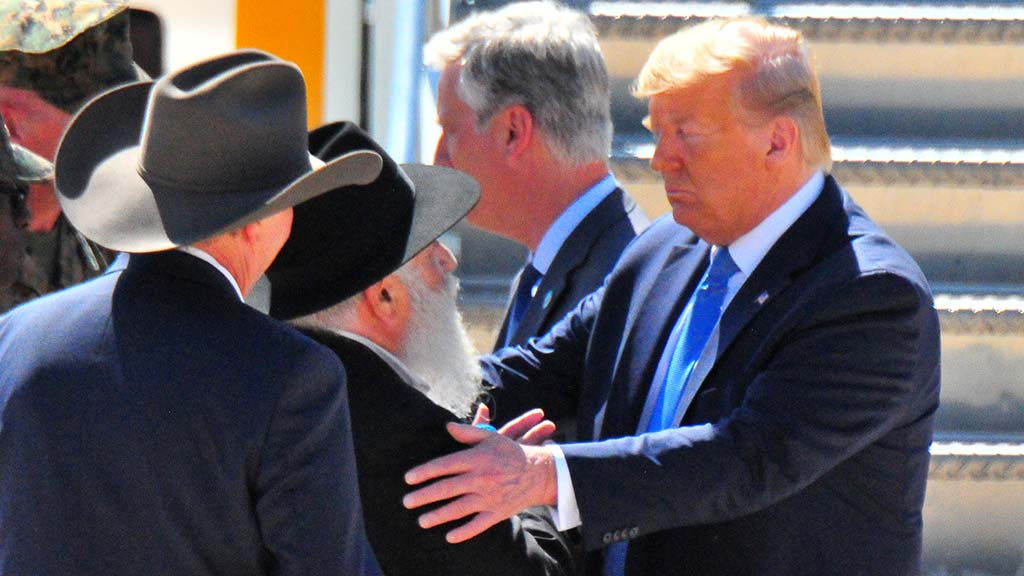 President Trump takes Rabbi Goldstein by the shoulders as they chat at Miramar