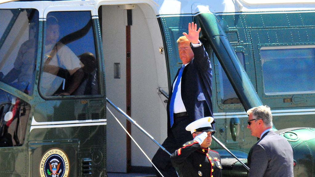 President Trump waves goodbye to a crowd of about 70 at Marine Corps Air Station Miramar.