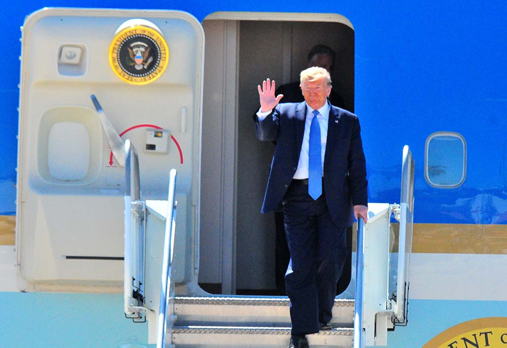 President Trump waves hello at Marine Corps Air Station Miramar upon exiting Air Force One.