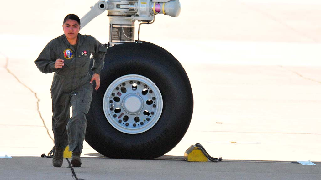 Flight line crew member sprints back after setting blocks for Air Force One.
