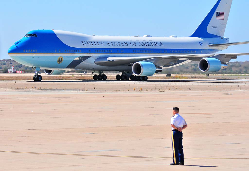 A Marine awaits taxiing Air Force One after 11:18 a.m. arrival at Miramar.