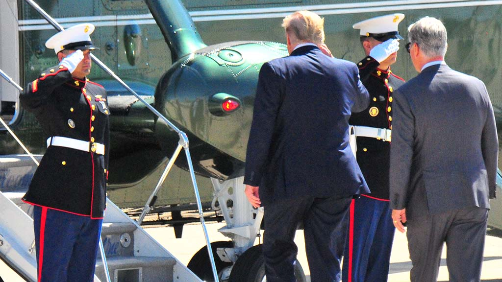 President Trump salutes as he boards Marine One with Robert O'Brien, his new national security adviser.