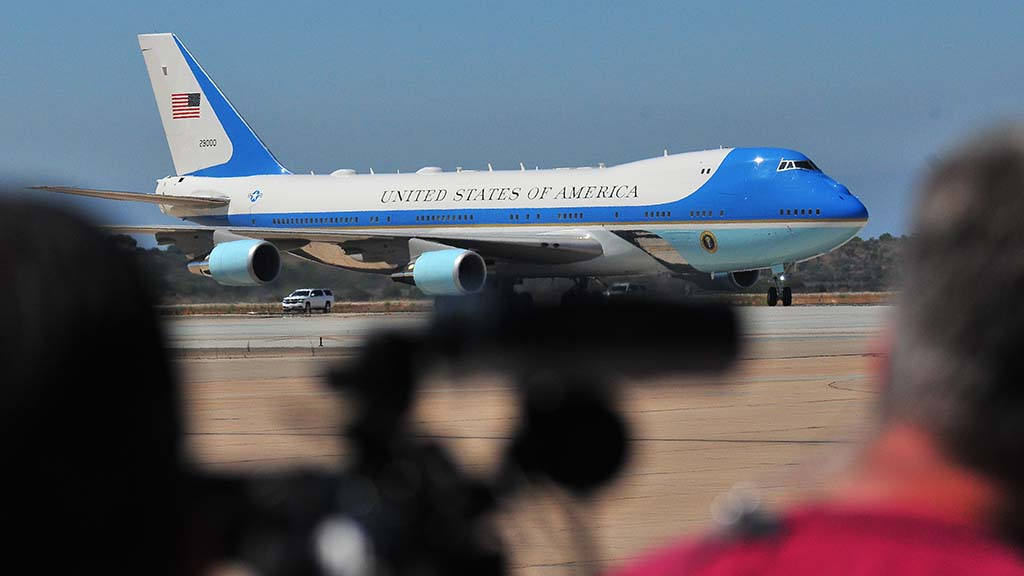 Air Force One taxis toward camera crews at Marine Corps Air Station Miramar.