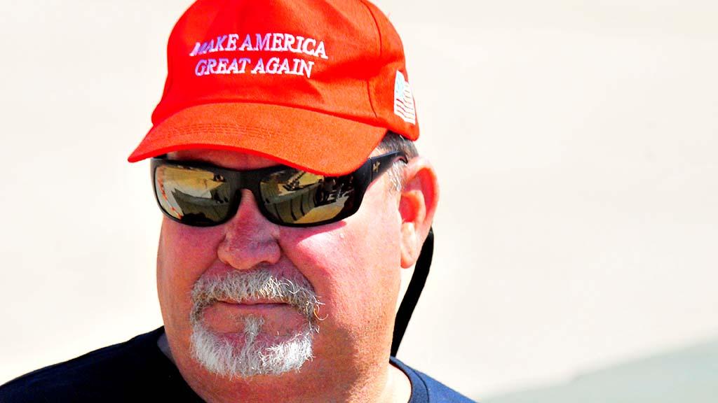 A crowd member sports President Trump's trademark ballcap.