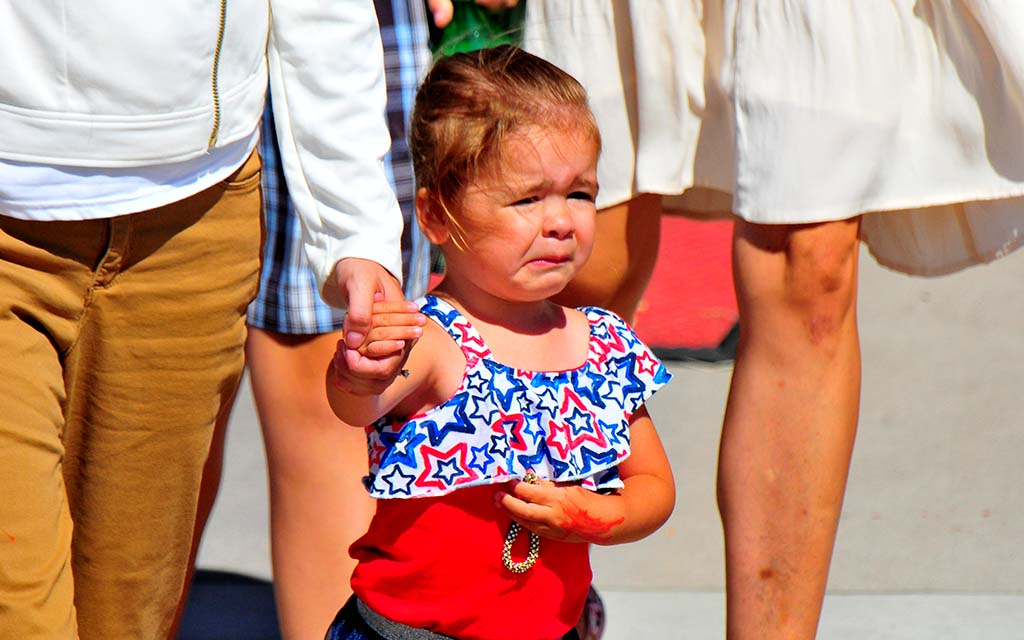 A young girl wasn't completely happy about being out in the sun for President Trump's arrival.