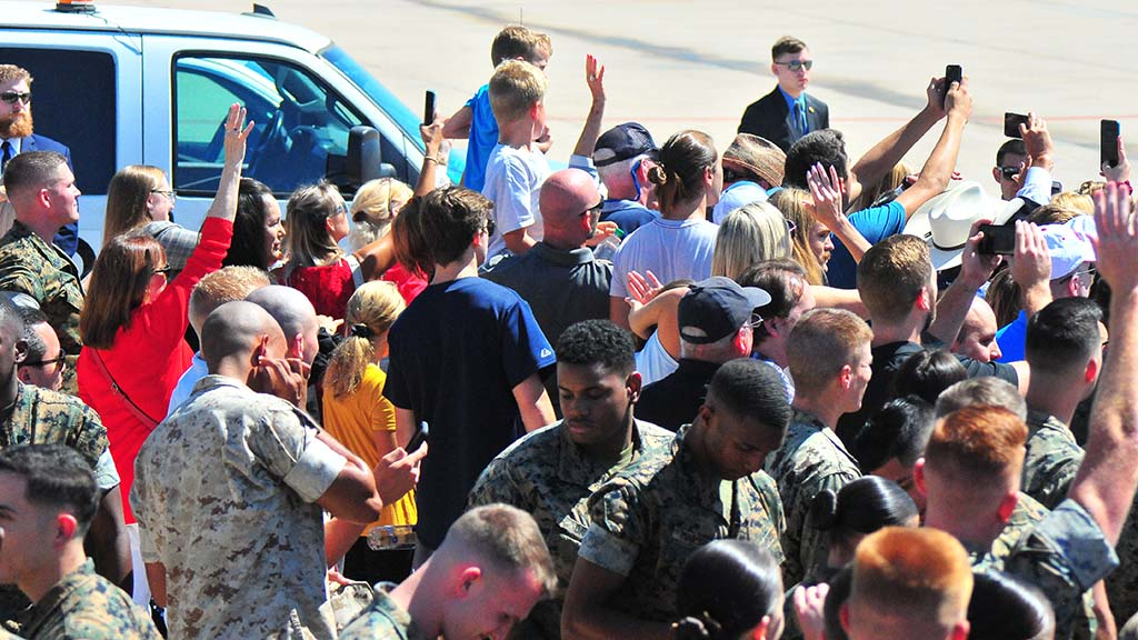 Marines and service families wave goodbye to President Trump after his 10-minute stop at Marine Corps Air Station Miramar.