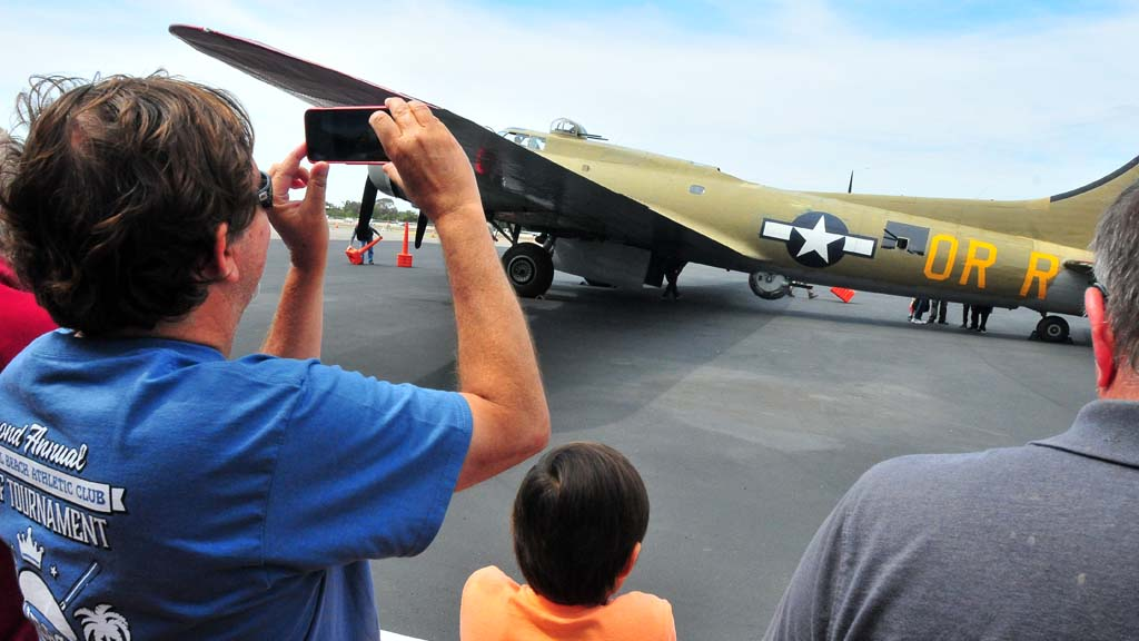 Plane enthusiasts greeted the B-17 as it landed at McClellan-Palomar Airport in May.