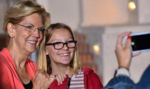 """Sen. Elizabeth Warren did her famed """"pinky promise"""" with children in the selfie line."""