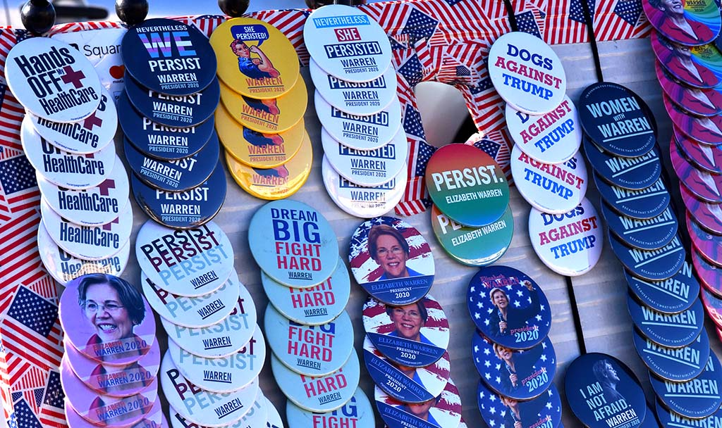 Campaign buttons were on display along the sidewalk in front of Waterfront Park.