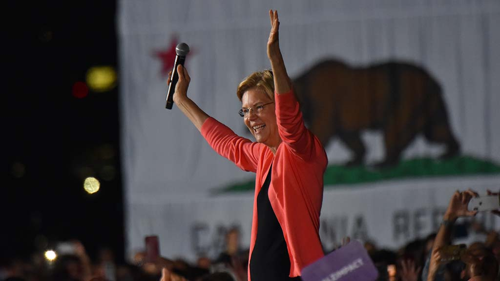 "Sen. Elizabeth Warren, backed by a California state flag, said: ""I see this as our moment."""