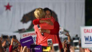 Sen. Elizabeth Warren hugs Assemblywoman Lorena Gonzalez after being introduced in San Diego.