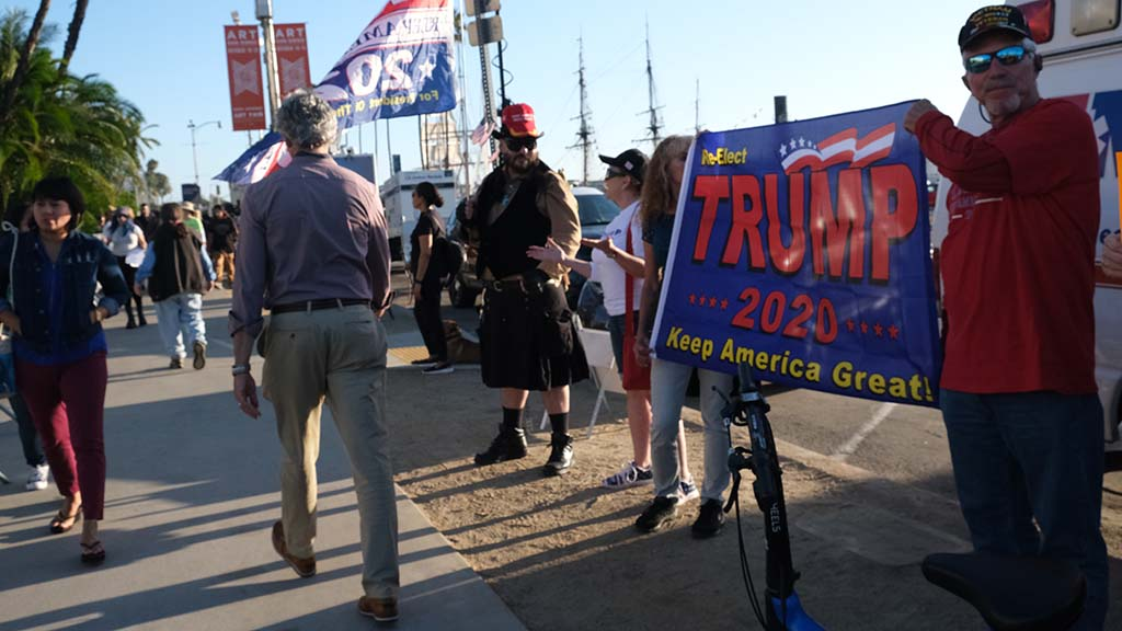 A dozen or so counterprotesters on behalf of President Trump kept up a steady chatter about socialism.