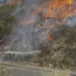 Flames from Talmadge-area brush fire