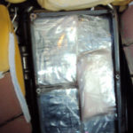 Drugs hidden in a metal box inside one of the SUV's backseat headrests