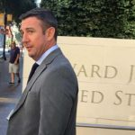 Trailed by news cameras but no protesters, Rep. Duncan D. Hunter leaves federal court after agreeing to new trial date. Photo by Ken Stone