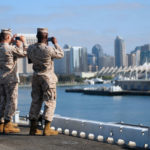 Marines aboard the USS Essex snap photos of the San Diego skyline