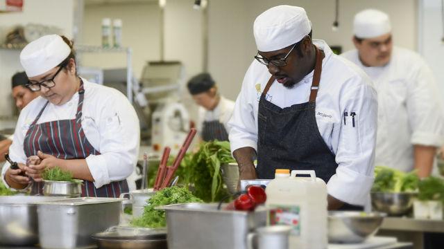 Mesa College students preparing food