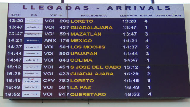 Arrivals board at Cross Border Xpress