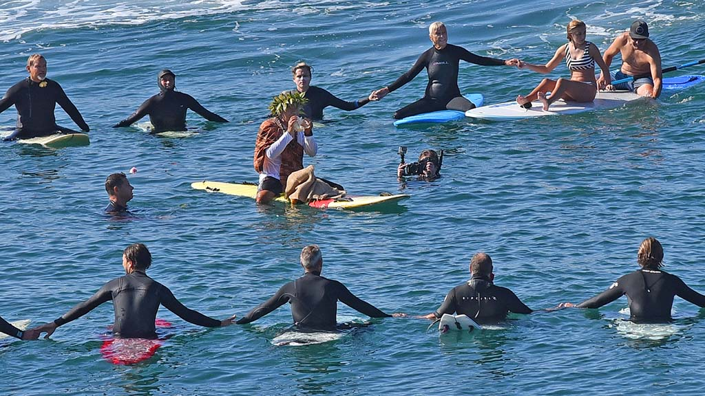 Hawaiian elder Kimokeo Kapalulehua lead a blessing during a paddle out in La Jolla.
