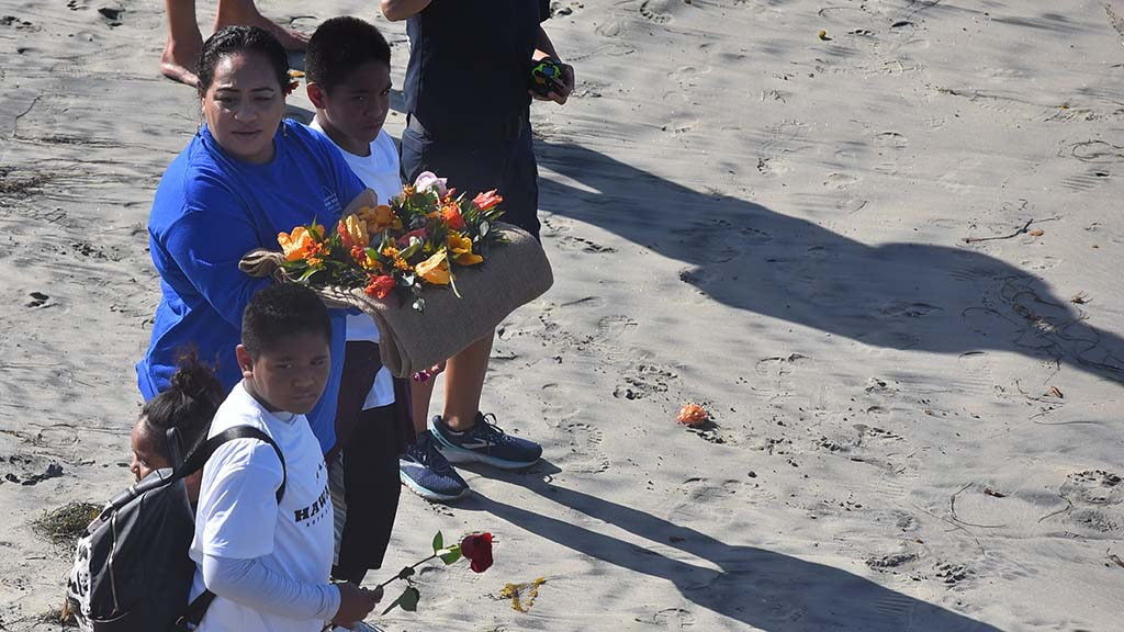 Flowers were arranged for the paddle out in honor of ocean scientist Walter Munk at the Scripps Pier.
