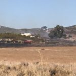 Cal Fire crews battle brush fire