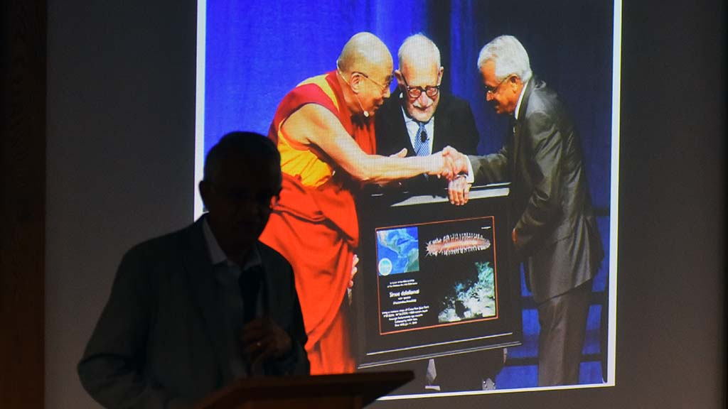 Veerabhadran Ramanathan shows picture of himself and his late Scripps colleague Walter Munk meeting the Dalai Lama.