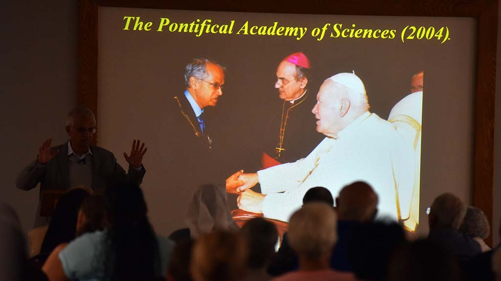 UCSD's Veerabhadran Ramanathan showed slide of his 2004 meeting with Pope John Paul II.
