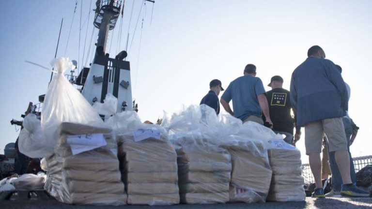Coast Guardsmen prepare bails of cocaine to be offloaded from the Coast Guard Cutter Alert in San Diego.