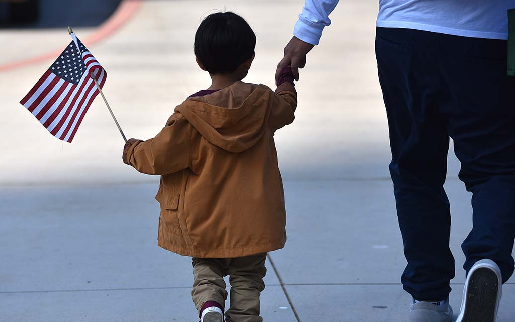 A young boy heads to the San Diego Veterans Day Parade route
