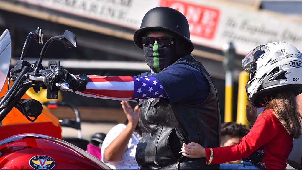 A member of the San Diego chapter of the U.S. Armed Forces Green Knights rides down the parade route.