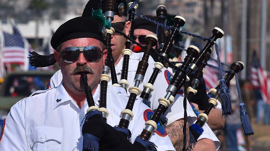 Members of the Police Emerald Society Pipe Band from Nassau County, New York entertain the spectators at the parade.