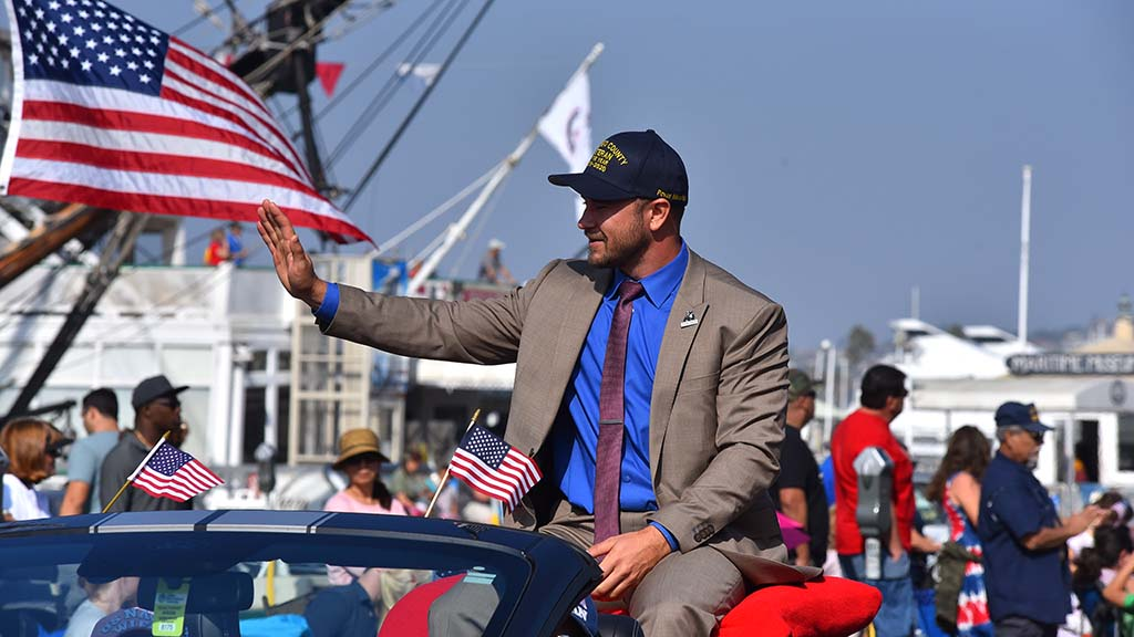 San Diego County Veteran of the Year 2020 Povas Miknaitis waves to the crowds.