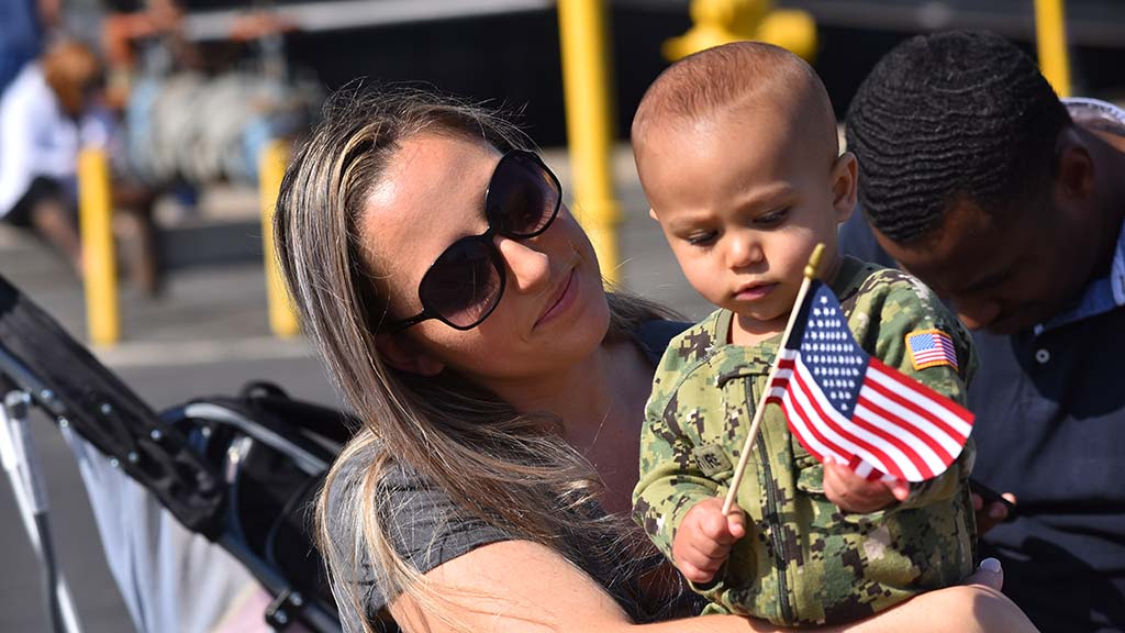 Brittany Eldridge and her baby, Gabriel, enjoyed the family outing at the Veterans Day Parade.