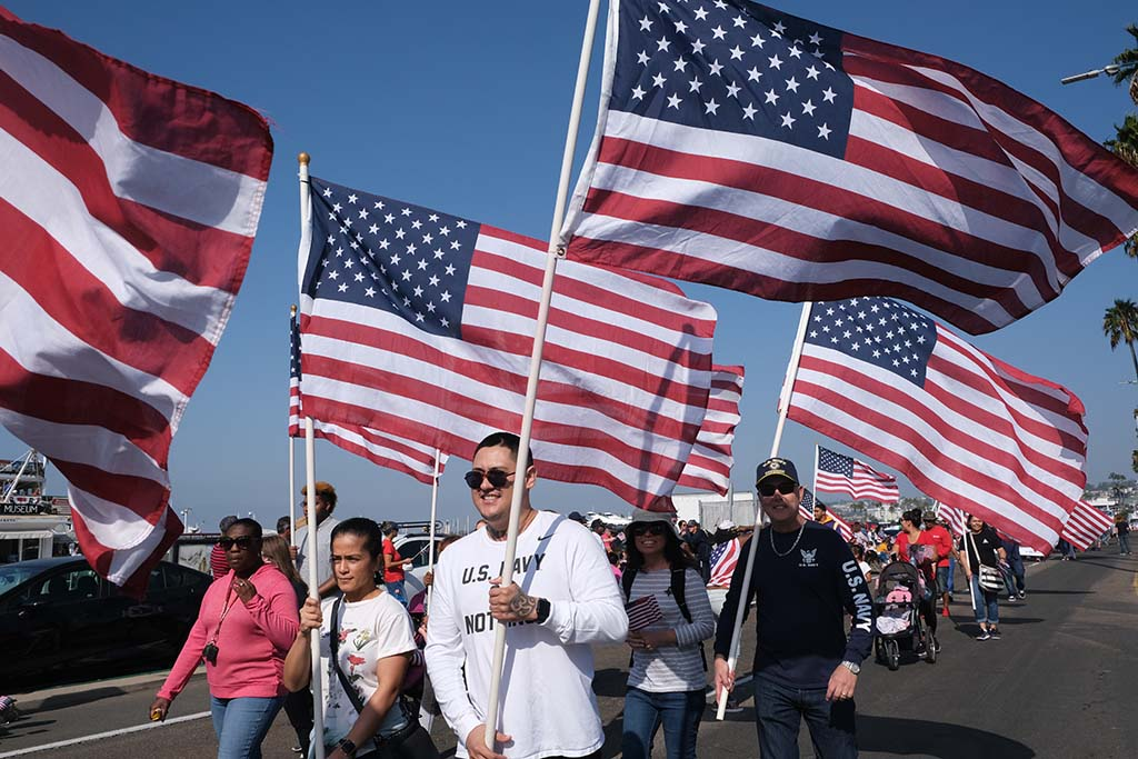 Members of the Veterans Association carry a cluster of flags along the parade route.